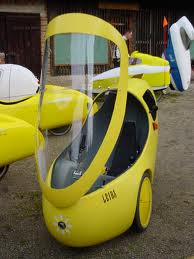 A yellow Go-One velomobile with the canopy open